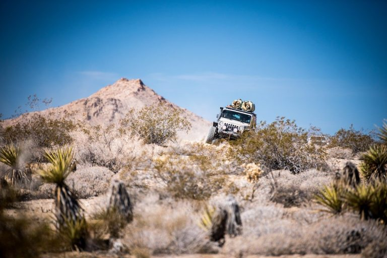 Rebelle Rally Jeep Wrangler on the rocks